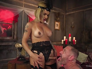Transsexual mistress TS Foxxy fucks anal hole of several submissive dude