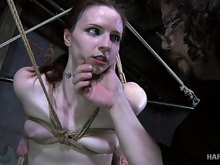 The palpitation toy goes here work out of reach of Claire's swollent pussy in a BDSM video